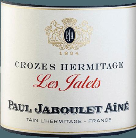 Beim Anblick des Les Jalets Rouge Crozes Hermitage von Domaine Paul Jaboulet Aîné zeigt sich eine schöne, glänzende, rubinrote Farbe mit violetten Glanzlichtern. Das aromatische Bouquet erinnert an rote, säuerliche Waldbeeren mit einer finalen würzigen Noten. Der Gaumen mit dem vollen Auftakt wirkt wohl balanciert und sanft, mit Tiefe, schöner Fülle und feinen Lakritznoten im Abgang. Speiseempfehlung für denLes Jalets Rouge von Domaine Paul Jaboulet Aîné Diese Rotweincuvée ist ein wunderbarer Genuss zu saftig gegrilltem Entrecote mit grünem Pfeffer, Lammragout mit geschmorten Schalotten oder Kasseler im Teigmantel.